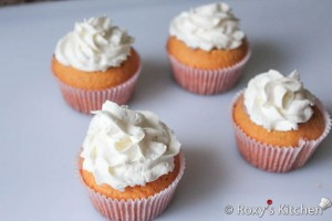 Strawberry Cupcakes - Top cupcakes with whipped cream
